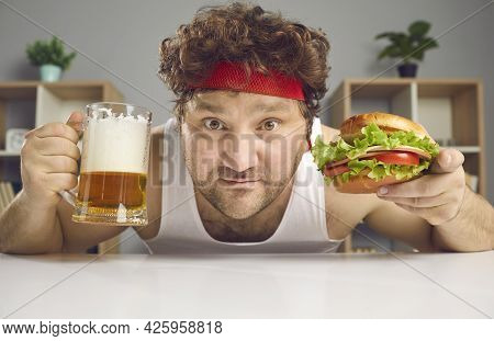 Funny Fat Man In Sportswear With Beer Glass Pint And Hamburger Closeup Portrait