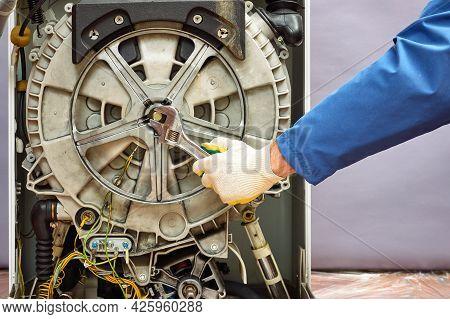 Working Professional Foreman Repairing Washing Machine Fixing