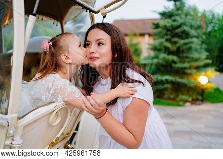 Mom And Daughter In The Carriage. A Fabulous Holiday For A Child.