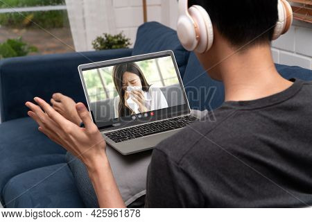 Asian Man Video Conference Meeting With Sick Girlfriend To Encourage And Inquire About Illness. Conc