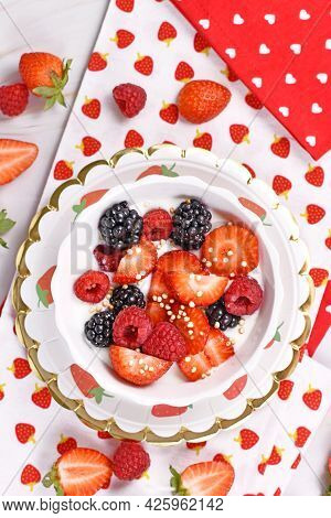 Top View Of Berry Mix Yogurt Bowl With Strawberry, Raspberry And Blackberry Fruits And Puffed Quinoa