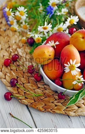 Summer Harvest Of Fruits. Ripe Apricots For Cooking Jam, Sugar, Wildflowers On A Stele Wooden Table.