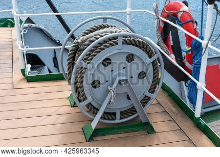 Bobbins With A Rope On The Deck Of The Ship Close-up. Mooring Of The Ship.