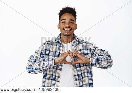Stylish African American Man Smiling, Showing Heart On Chest Gesture, I Love You, Confess That He Li