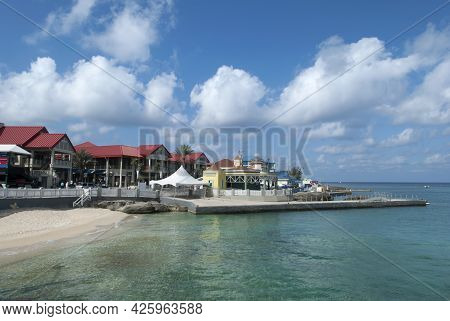 The View Of George Town Beach And A Pier On Grand Cayman Resort Island (cayman Islands).