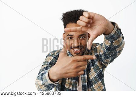 Creative African American Male Student, Guy Looking Through Finger Frames And Smiling Amused, Captur