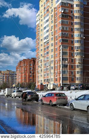 Balashikha, Russia - March 19, 2021. Residential Area On The Spring Sunny Day. Snow Melting On The R