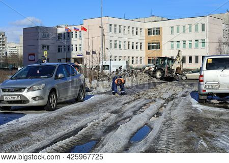 Balashikha, Russia - March 19, 2021. Spring In The City. Municipal Service Is Clearing The Street Of