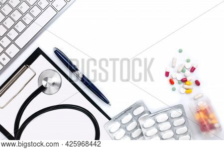 Top View Of Doctor's Desk With Pen, Medical Stethoscope, Pills And Clipboard. Medical Concept. Flatl