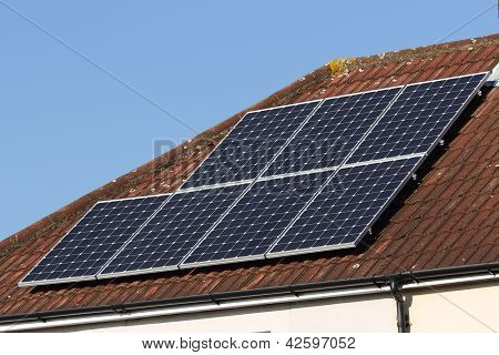 Solar photovoltaic panel roof array