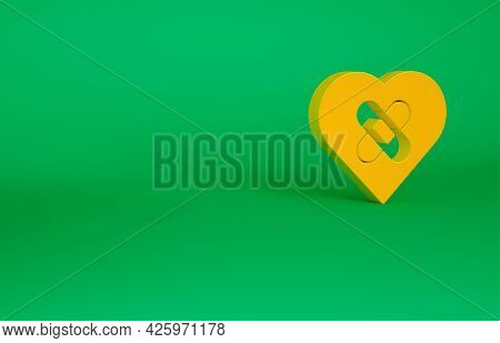 Orange Healed Broken Heart Or Divorce Icon Isolated On Green Background. Shattered And Patched Heart
