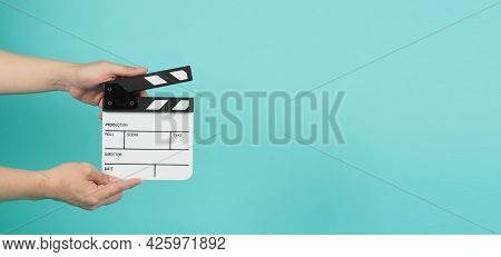 Hand Is Holding Clapper Board Or Clapperboard Or Movie Slate.it Is Used In Film Production And Movie