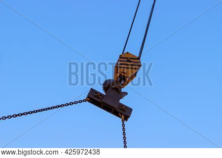 Slings And Hook Of A Construction Crane Against A Blue Sky. Industrial Background