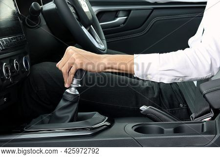 Male Hand Holding Manual Gearbox Of Car
