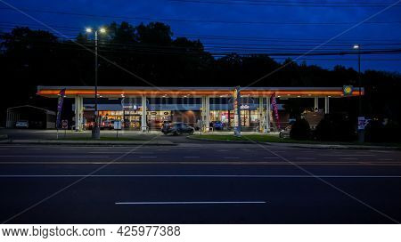 NORWALK, CT, USA - JUNE, 24, 2021: Shell gas station on Post Road  with evening lights