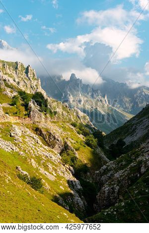 Spectacular Mountainous Landscape With A Road Running Through Its Gorge. Picos De Europa National Pa