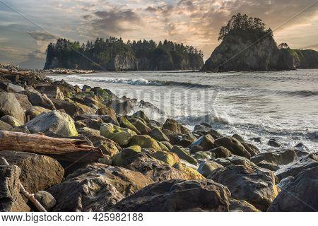 Rialto Beach Washington State. Sea Stacks Seen In Distance. Colorful Overcast Skies. Waves Crashing