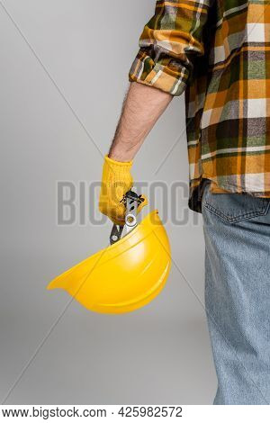 Back View Of Cropped Workman Holding Hardhat Isolated On Grey, Labor Day Concept