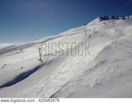 Chairlift On The Snow Covered Ski Slope. Bright Winter Sunny Day At Ski Resort. Erciyes Mount, Kayse