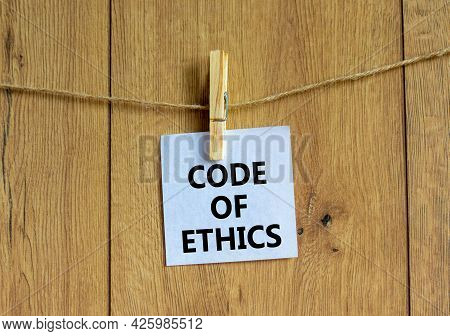 Code Of Ethics Symbol. White Paper With Words 'code Of Ethics', Clip On Wood Clothespin. Beautiful W