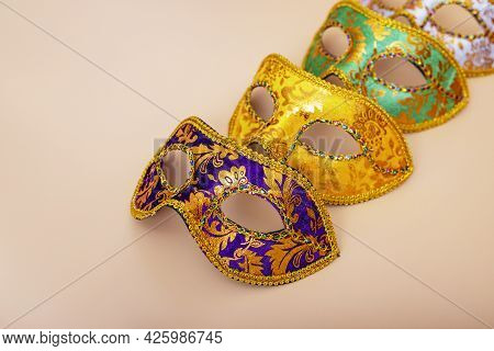 Carnival Masks On Color Background. Purim Celebration Concept (jewish Carnival Holiday). Masquerade
