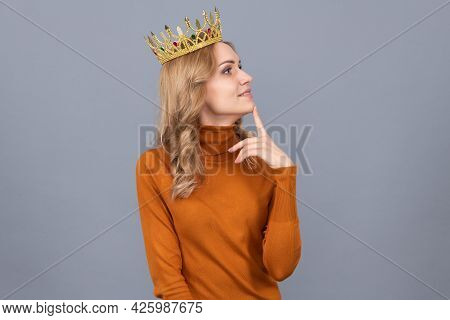 Thoughtful Blonde Woman In Crown. Arrogance And Selfishness. Portrait Of Glory.