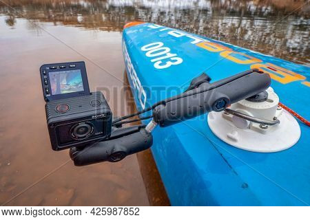 Fort Collins, CO, USA - December 25, 2019: Sony RX0 2 ultra compact action  camera mounted with a suction cup on a deck of racing stand up paddleboard.