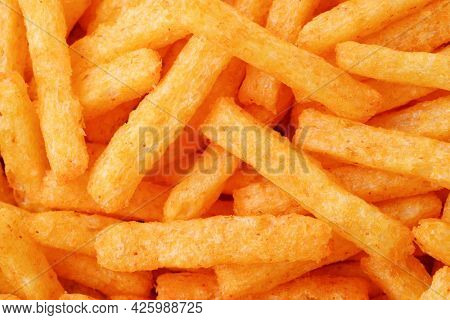 Top view of spicy cheese puff sticks background