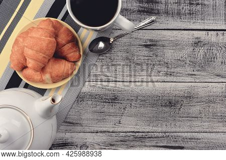 Homemade Croissant Served With Black Coffee Or Americano. Delicious Breakfast With Fresh Croissant.
