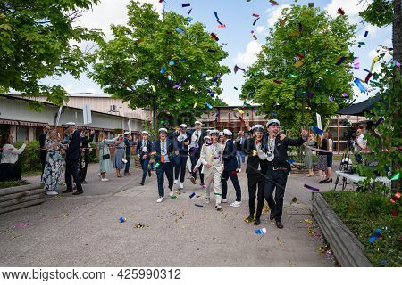 Stockholm County, Sweden - June 4, 2021: Summer Outdoor Graduation Ceremony. Many Students With Pare