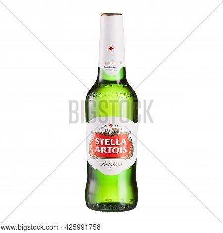 Stella Artois Premium Lager Beer Bottle On Glass Table Isolated Against White Background - Volgograd