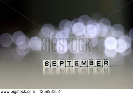 SEPTEMBER is a word written on a white block. SEPTEMBER is the word for your design, concept. Beauti