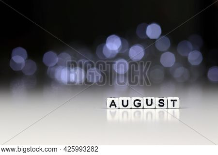 AUGUST is a word written on a white block. AUGUST is the word for your design, concept. Beautiful bo