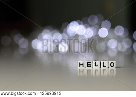 Hello Is A Word Written On A White Block. Hello Is The Word For Your Design, Concept.