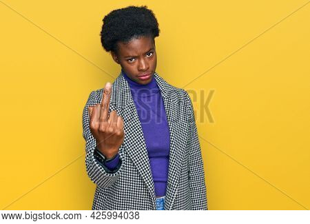 Young african american girl wearing casual clothes showing middle finger, impolite and rude fuck off expression