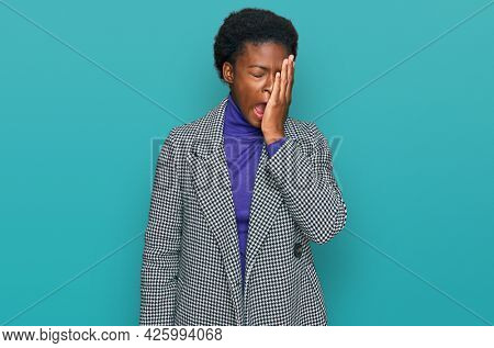 Young african american girl wearing casual clothes yawning tired covering half face, eye and mouth with hand. face hurts in pain.