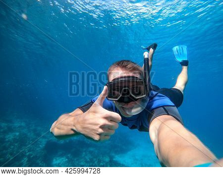 Man In Snorkel Mask Doing Selfie Underwater. Vacation, Freediving And Travel Concept.