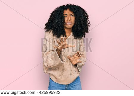 Young african american girl wearing casual clothes disgusted expression, displeased and fearful doing disgust face because aversion reaction. with hands raised