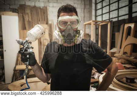 Funny Worker. Worker Posing With Air Brush Painter Varnish