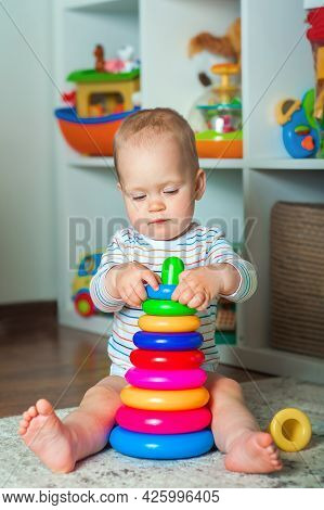 Toddler Plays Colorful Home Constructor And Copy Space. Development Of Children From Birth.