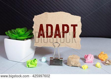 Adapt Word Written On Pink Envelope Near Office Supplies. Text.