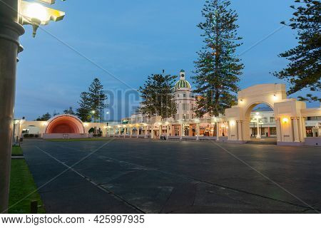 Napier New Zealand - June 1 2015; Marine Parade Sound Shell With Colonnade, Norfolk Pines And City D