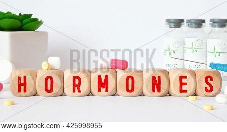 Hormones Word Written In Wooden Cube, Medical Concept