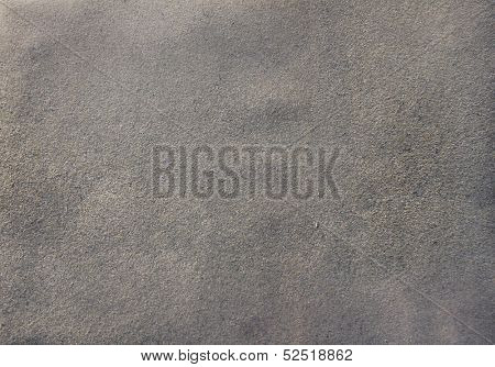 Background of black chamois leather and grunge natural suede texture closeup view