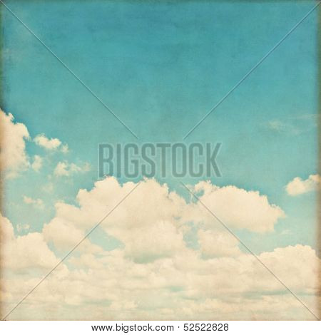 White clouds in blue sky in grunge and retro style.
