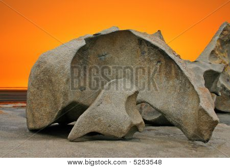 Sculpted Rock Formation And Orange Sky
