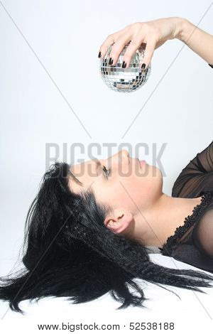 Beautiful Woman With Discoball Lying