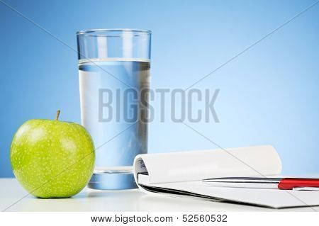 Notepad With A Drink And An Apple