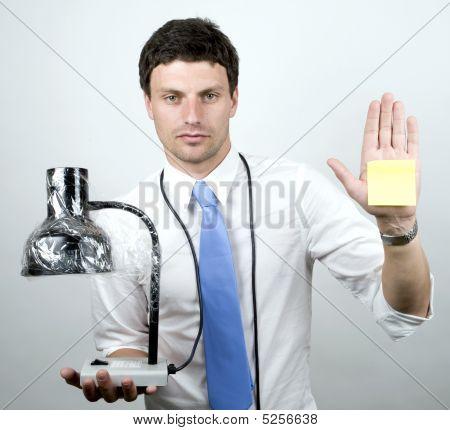 Man Holds Lamp