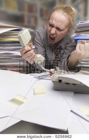 Businesswoman Yelling Into Telephone Receiver